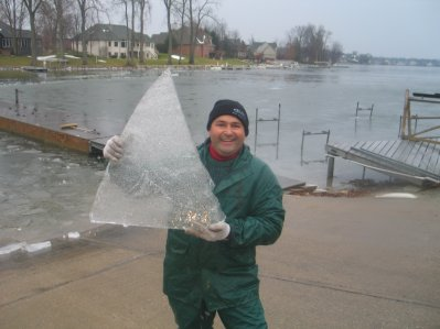 Mike Geryak Holds a Piece of Ice that Looks Like a Main Sail